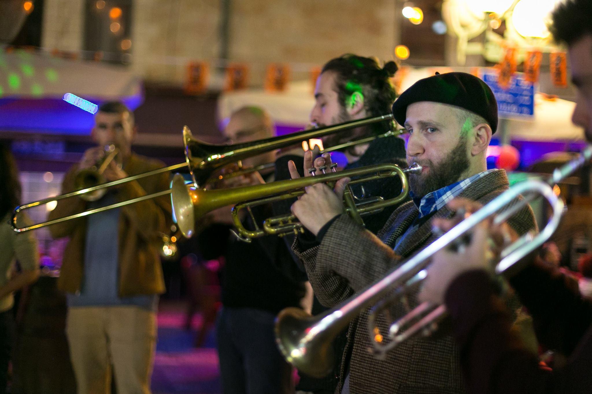 horn and trombone players perform at Shaon Horef Jerusalem winter festival