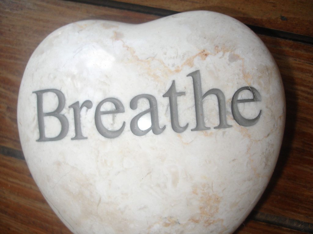 """Heart-shaped rock engraved with the word """"Breathe"""""""