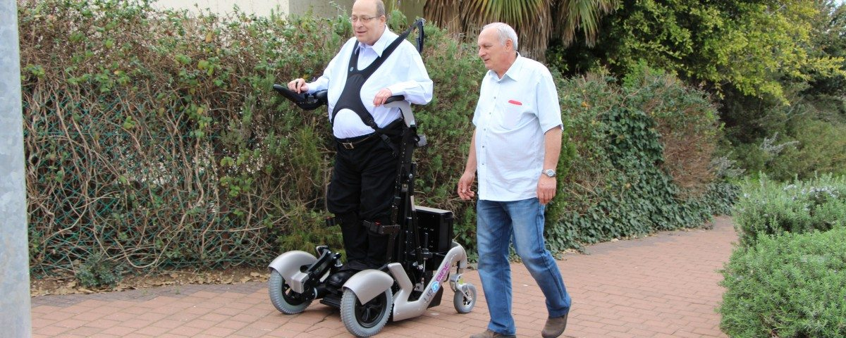 Dr Amit Goffer goes utside standing up for first time using Israeli invention upright wheelchair